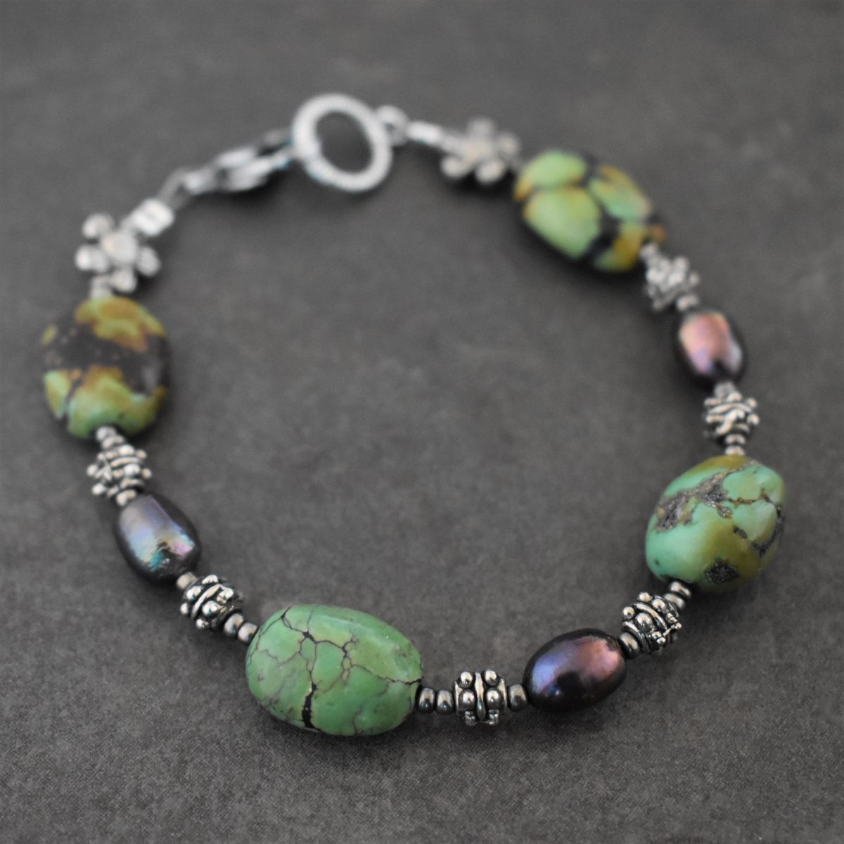 Green turquoise and purple Peacock pearl bracelet