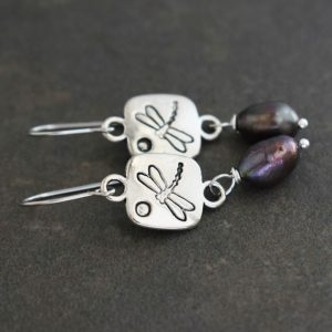 silver squares with dragonfly on them an purple pearls earrings