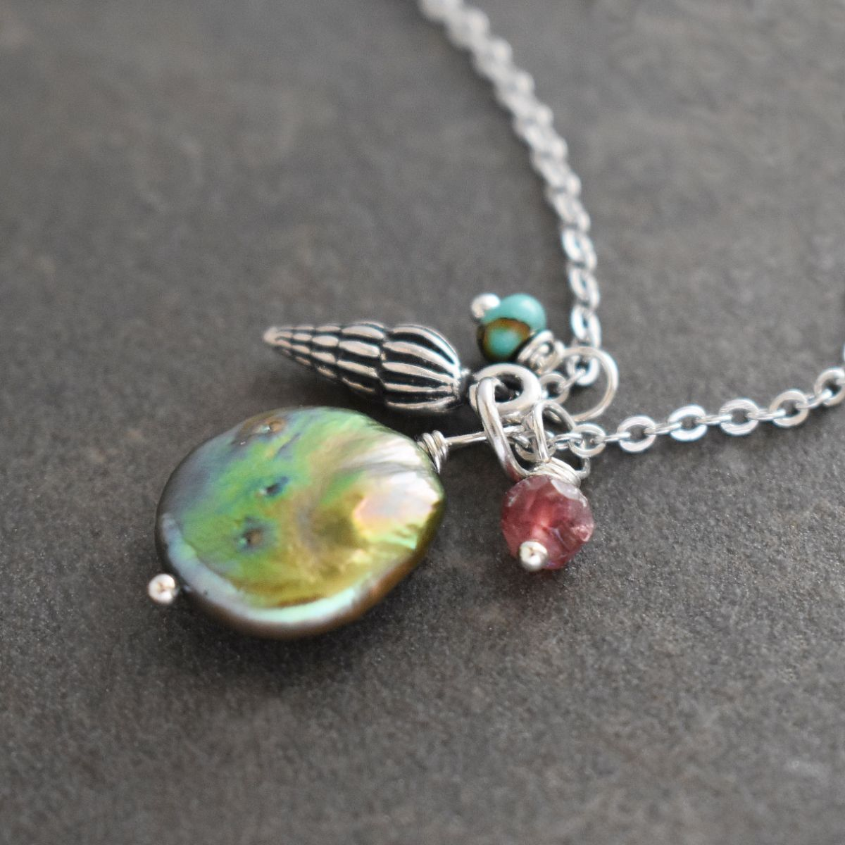 Wentletrap seashell with green coin pearl and gemstone pendant