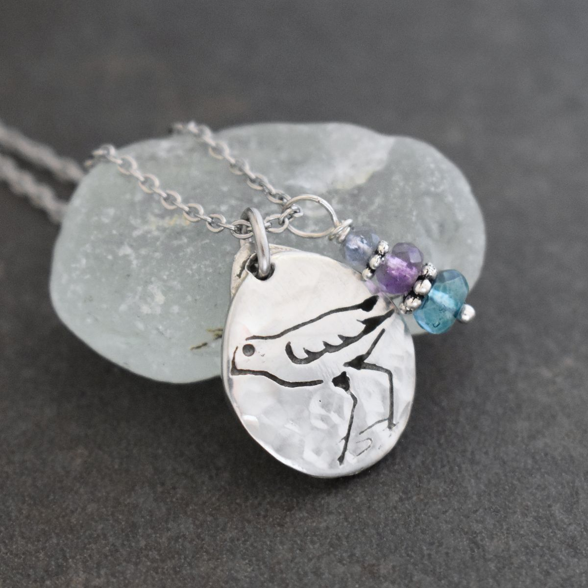 Sandpiper in water necklace