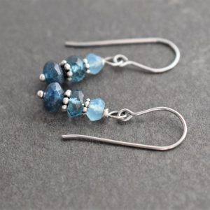 blue stacked gemstone earrings with silver spacer between