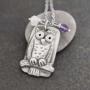 silver owl with white moonstone and purple amethyst gemstones