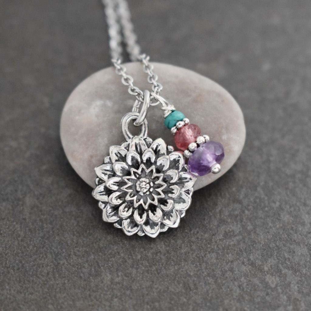 Silver flower Pendant with purple and pink gemstones