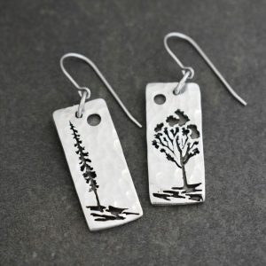 long rectangles with a pine tree and aspen tree on them