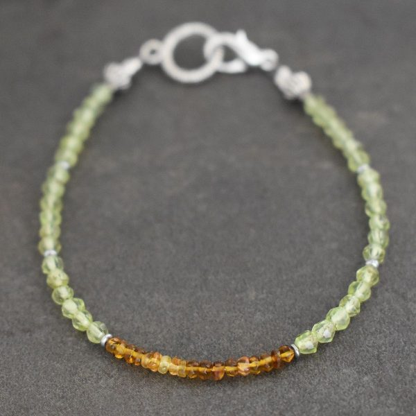 Beaded bracelet with green and brown gemstones