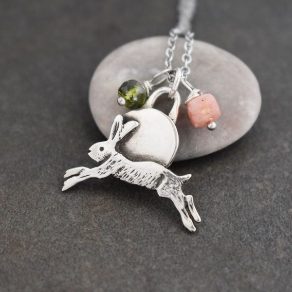 silver rabbit pendant with green and pink gemstones