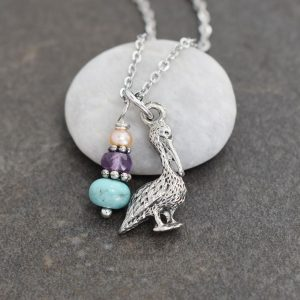 silver 3d pelican bird with peach, purple and turquoise gemstones