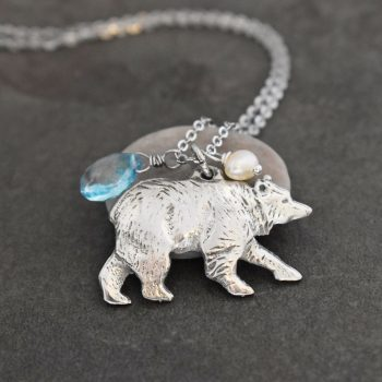 silver bear pendant with blue gemstone and white pearl