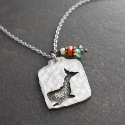Silver pendent with whale with white pearl red coral and green gemstone charm