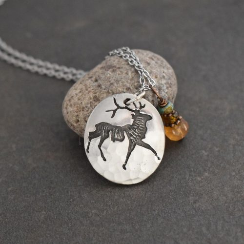 silver oval with elk pendant with brown and orange gemstone charm