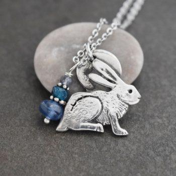 silver rabbit pendant with blue gemstones