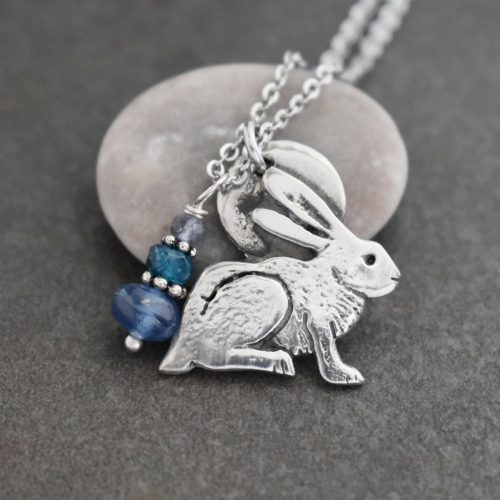 silver rabbit pendant with blue gemstones