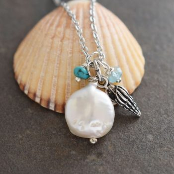 Wentletrap seashell with green coin pearl & gemstones.