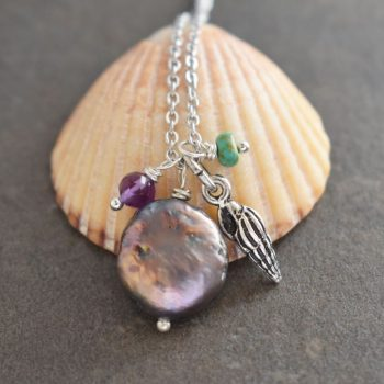 Wentletrap seashell with lavender coin pearl & gemstones.
