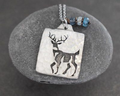 deer pendant with blue gemstones charm