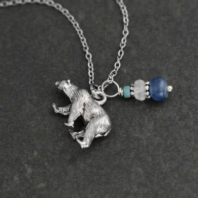 Polar bear pendant wwith turquoise, moostone and kyanite